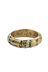 "From the Benjamin Zucker ""Cycles of Life"" collection  Memorial and Memento Mori Ring. This gold hoop ring is enameled black outside with a white skeleton, a skull, an hourglass, skull and crossed bones, a snake, a crossed pick and shovel; it isinscribed within WH Nov. 18 1661 NOT LOST BUT GONE BEFORE. Alock of the deceased's hair is inside the hoop. Dated 1661"